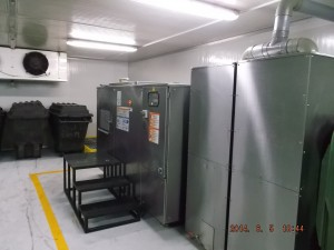 Oklin's GG100 food waste composting machine installed in a temperature regulated room